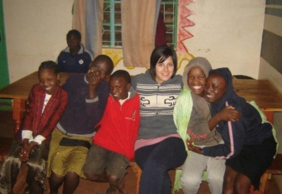 Nicole spends time with children in the community during her time in Kenya